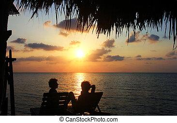Couple in the sea photo silhouette. Sunset on Koh Phangan