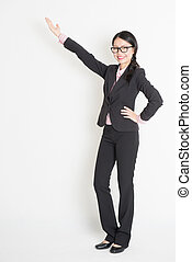 Asian business woman pointing