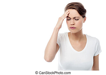 Woman has a migraine - Worried woman feeling the pain in...