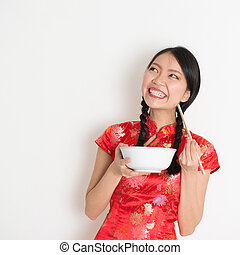 Asian chinese girl eating and looking up - Asian Chinese...