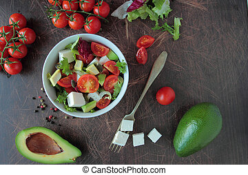 Salad in a bowl with fresh vegetable and feta cheese