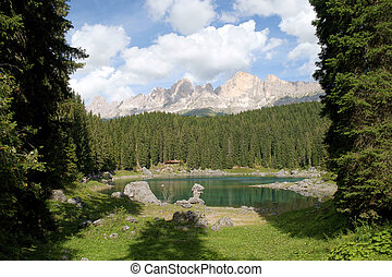 Carezza lake and Latemar - Scenic view of Carezza lake in...