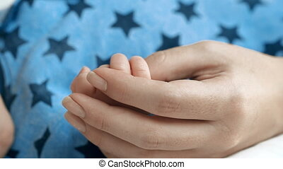 Teeny Hands - Unrecognizable mother massaging hands of her...