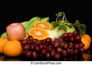 Fresh, healthy fruits - Mixes Fresh, healthy fruits on black...
