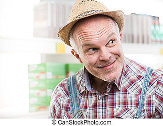 Funny farmer at supermarket making a face and looking...