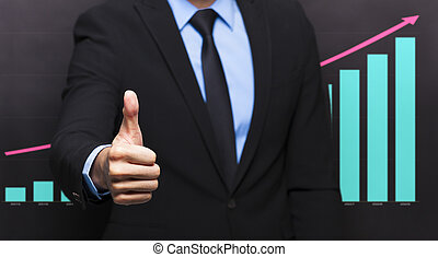 businessman with thumb up gesture and graph concept