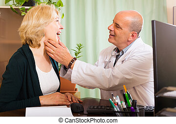 Doctor checking thyroid of woman - Doctor checking thyroid...