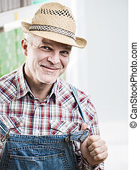 Smiling farmer - Smiling cheerful farmer posing in checked...