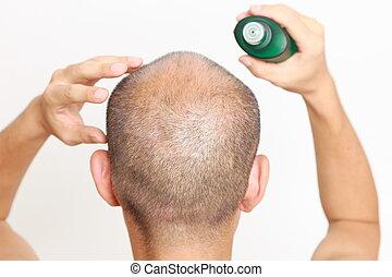 scalp massage - studio shot of a man doing scalp massage