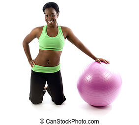 young and pretty hispanic latina black woman trainer wearing exercise tights and working out fitness core ball