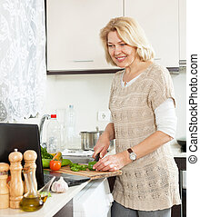 woman looking recipe for cooking in the internet in home...
