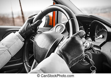 Hands on a steering wheel - Close-up of hands on a steering...