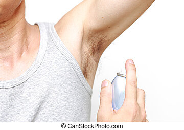 deodorizing spray - studio shot of a man spraying deodorant
