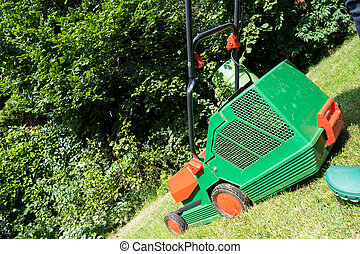 lawnmower in garden in summer time