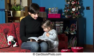 Mom Reading Christmas Book To Child