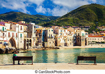 benches in the port of Cefalu - benches in front of old...