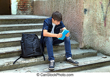 Sad Student with the Book on the landing steps