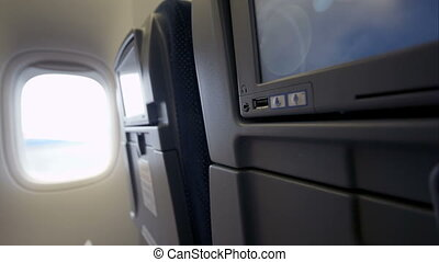 Connection of cell phone and seat monitor in plane via USB -...