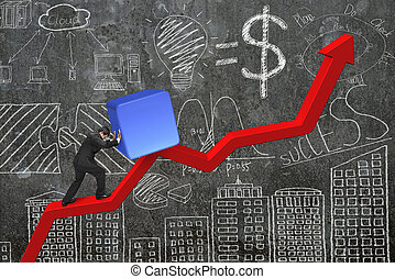 businessman pushing block at trend chart starting point with...
