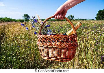 picnic blanket in landscape in summer time