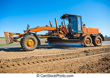 New roadworking tractor standing on edge of road