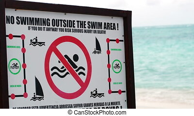Warning board with restrictions on the beach - Warning board...