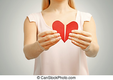 broken red heart in woman hands concept of relationship,...