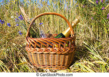 picnic basket in cornfield in summer time