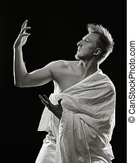 Young man and toga - Portrait, handsome young man sits in...