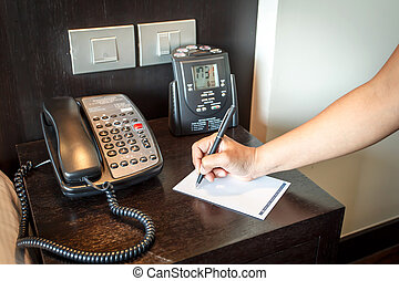 Hand holding pen with telephone