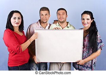 Group of friends hold a blank banner - Four friends standing...
