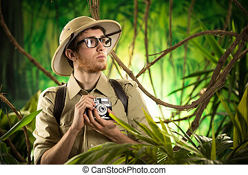 Young photographer in the jungle - Young explorer in the...