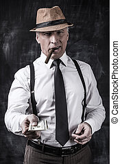 Money is not a problem Serious senior man in hat and...