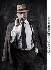 Powerful boss Serious senior man in hat and suspenders...