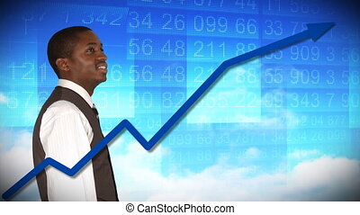 Businessman looking at a stock market - Smiling businessman...