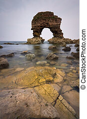 Coast of Tyne and Wear, UK - Rock arch on the coast of Tyne...