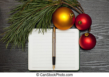 Christmas list - Fountain pen on a notebook on a wooden...