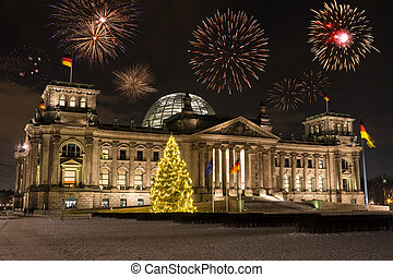 german parliament on new years eve with fireworks