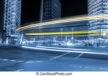 traffic at potsdamer platz in berlin by night