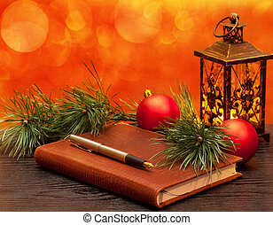 Christmas decoration - Fountain pen on a notebook on a...