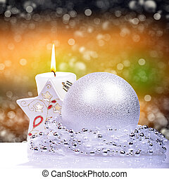 Christmas background with balls and candle