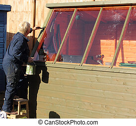 Painting a potting shed - An english lady Painting a potting...