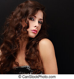 Beautiful fashion female model with long brown hair looking...