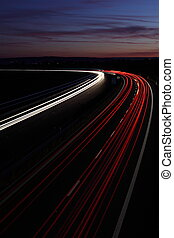 Night highway (speedway) - Cars in a rush moving fast on a...