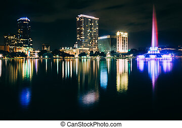 Fountain and the Orlando skyline at night, reflecting in Lake Eo