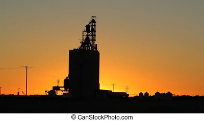 Grain elevator. Saskatchewan. - Grain elevator at dusk. Heat...