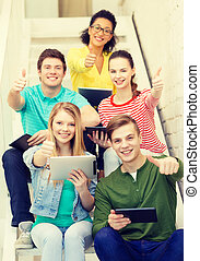 smiling students with tablet pc computer - education and...