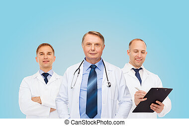 group of smiling male doctors in white coats - healthcare,...