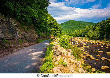 Road along Red Creek, in the rural Potomac Highlands of West...
