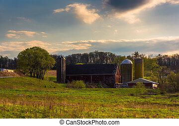Silos and barn on a farm in rural York County, Pennsylvania.